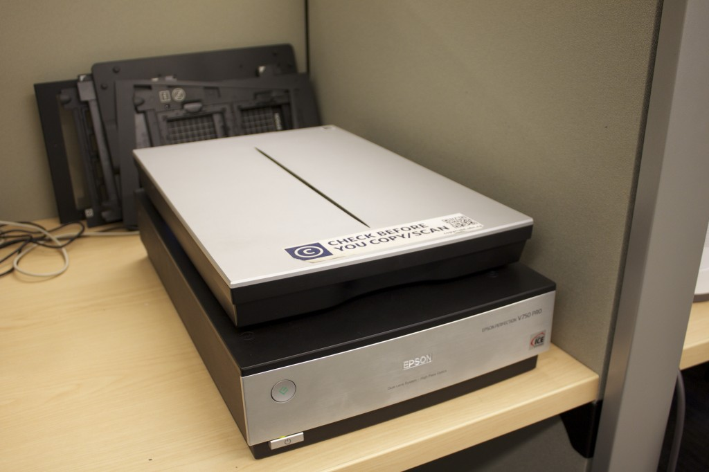 <c> An image of an Epson Perfection V750 Pro flat bed scanner in the Digitization Centre. </c>