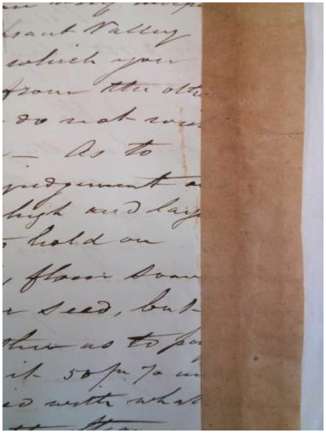 Document from the Royal Fisk Gold Rush Letters collection that requires the removal of a covering to access the writing underneath. The letters in the collection are bound together with tags and sewn into a volume. Parts of text are sometimes hidden by the tags. Photo by Anne Lama.
