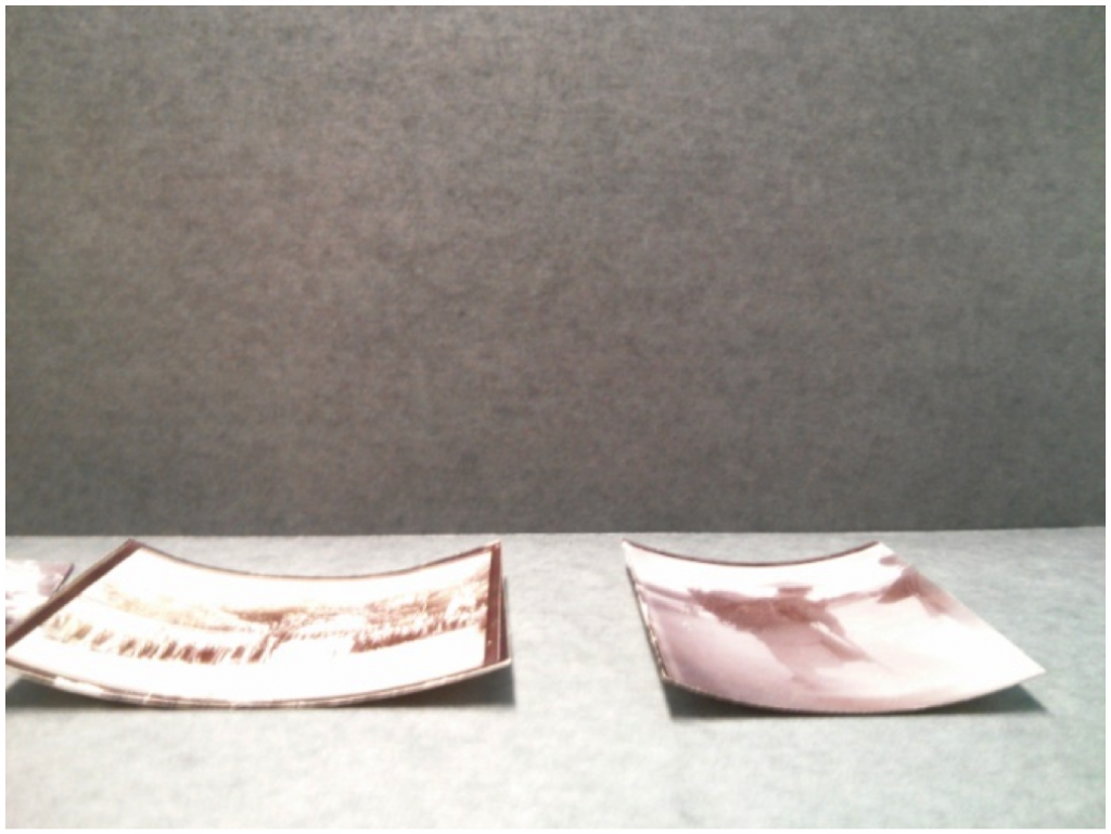 After shot of photographs that were flattened. Photo by Anne Lama.