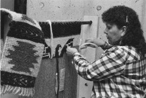 Musqueam weaver Barbara Cayou demonstrating Coast Salish weaving, 1988
