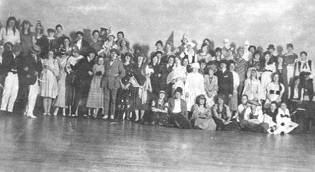 "Group photograph of the 1919 ""High Jinks"" costume party"